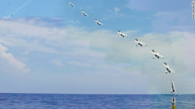 Deployed from the submerged submarine USS Providence, an unmanned aircraft is vertically launched.