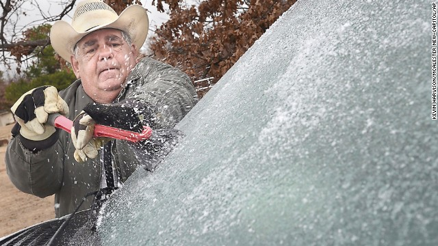 Stephen LeFlore scrapes ice from his windshield in McAlester, Oklahoma, on Thursday, December 5.