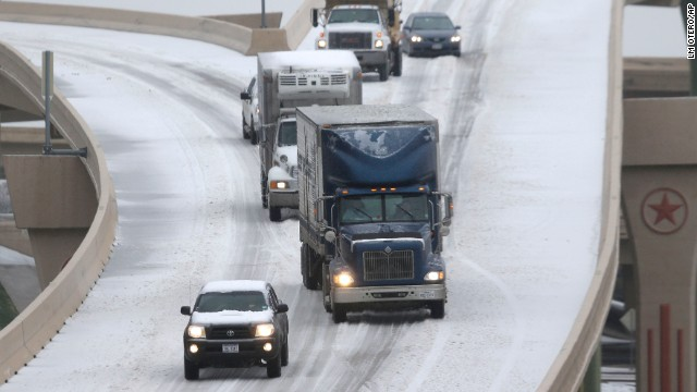 Traffic moves slowly along an ice-covered highway in Dallas on December 6.