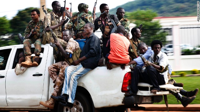 Seleka soldiers race through Bangui as gunfire and mortar rounds erupt in the capital December 5.