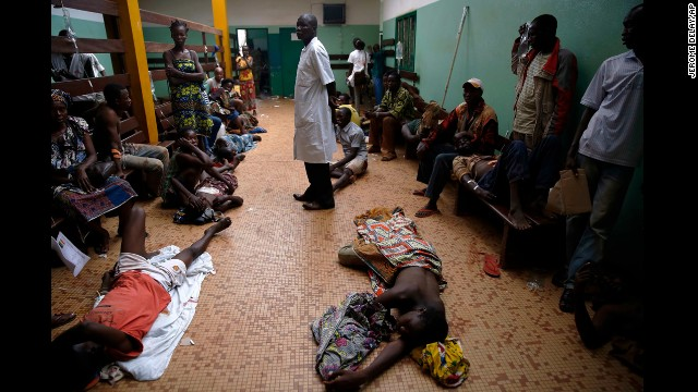 Wounded civilians lie on the floor of Bangui's hospital on December 5.