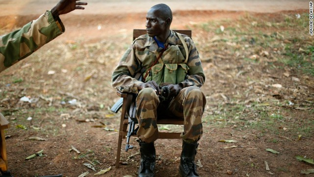 A Seleka soldier is briefed while manning a checkpoint in Boali, Central African Republic, on Wednesday, December 4.