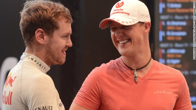 Sebastian Vettel (left) says it is hard to imagine that his former mentor Schumacher is still recovering from the effects of a skiing accident.