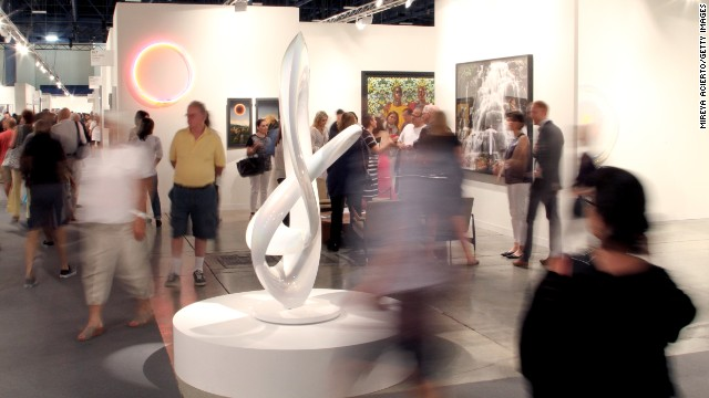 Art lovers move about at Art Basel Miami Beach on December 6, 2013.