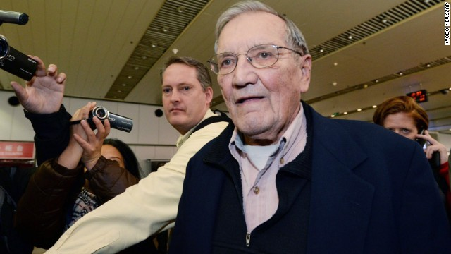 U.S. tourist and Korean War veteran Merrill Newman arrives at the Beijing airport on December 7 after being released by North Korea. Newman was detained in October 2013 by North Korean authorities just minutes before he was to depart the country after visiting through an organized tour. His son Jeff Newman said the Palo Alto, California, man had all the proper paperwork and set up his trip through a North Korean-approved travel agency.