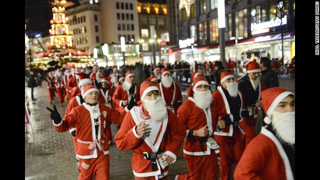 Runners dressed as Santa Claus take part in a Santa Run on December 6, in Hanover, Germany.