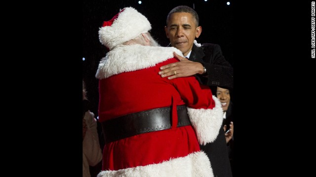 U.S. President Barack Obama hugs Santa Claus during the National Christmas Tree lighting ceremony on December 6.