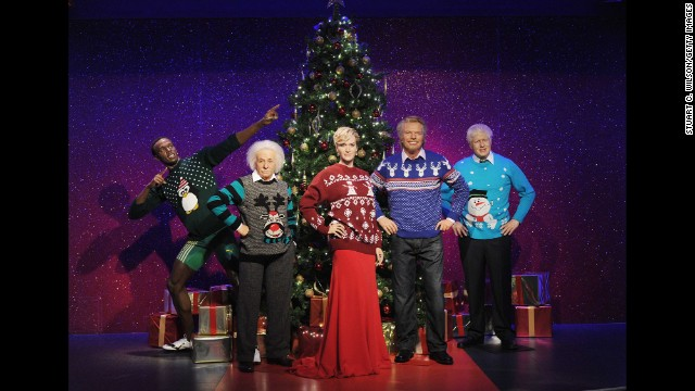 Wax figures of Usain Bolt, Albert Einstein, Kate Winslet, Richard Branson and Boris Johnson are dressed in Christmas sweaters December 3 in support of the Save The Children campaign at Madame Tussauds in London.
