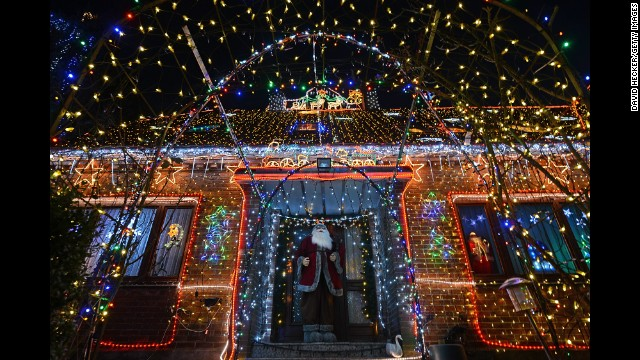 A figure of Santa Claus stands in front of the House of Family Vogt, lit by more than 450,000 lights, on November 30 in Buecken, Germany.