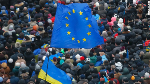European Union and Ukrainian national flags fly above a crowd of pro-EU activists in Independence Square on December 8.
