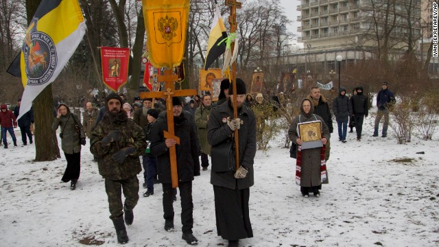 Orthodox believers, carrying icons and crosses, walk during a religious procession outside the parliament building in Kiev on December 6.