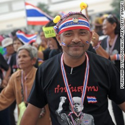 Thai anti government protesters dance as they rally at Bangkok's Government Complex on December 8, 2013.