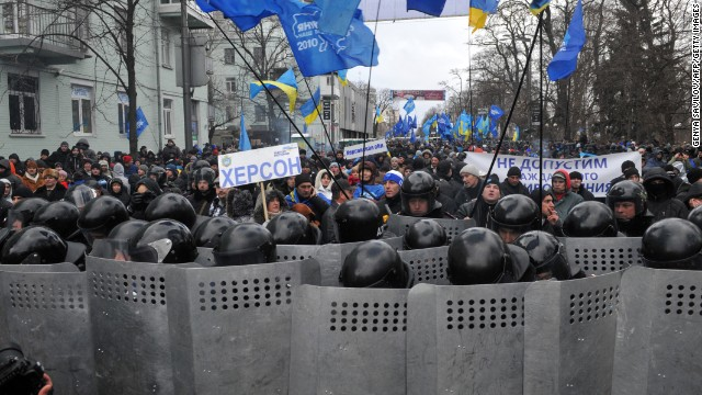 Riot police block protesters during the December 8 rally.
