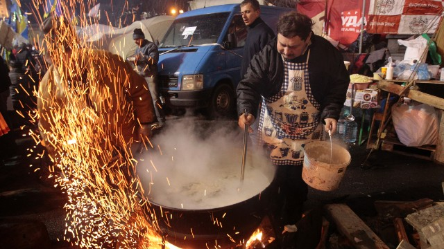 Protesters prepare food at a camp in Independence Square on December 7.