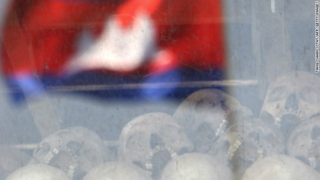 A Cambodian flag reflected in a glass cabinet displaying skulls during the 'Day of Anger' ceremony in 2008.