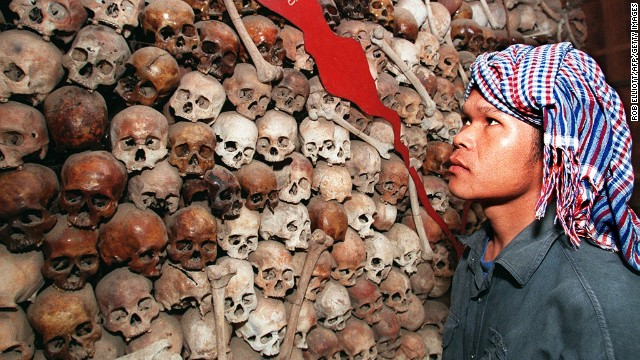 Cambodian Sam Vishna looks at a mixture of brown and white skulls that make up a map of Cambodia at Tuol Sleng Prison Museum in Phnom Penh in 1998.