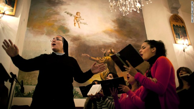 A choir sings hymns during a special service in the honor of Mandela on December 8 at the Holy Family Church in the West Bank city of Ramallah. Palestinians mourned Mandela as a loyal champion of their cause.