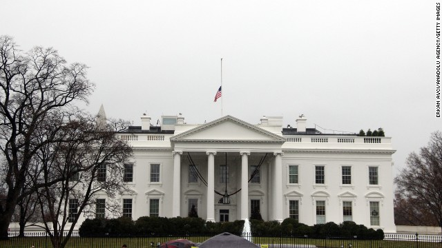An American flag flies at half-staff above the White House in Washington on December 6.