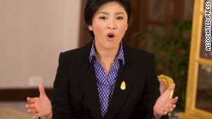 Protesters say Prime Minister Yingluck Shinawatra\'s government is influenced by her brother, the former PM.