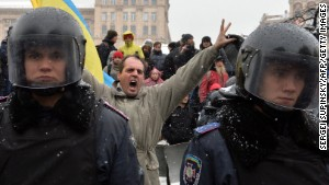 A protester shouts behind riot policemen standing guard in Independence Square in Kiev, Ukraine, on Monday, December 9.
