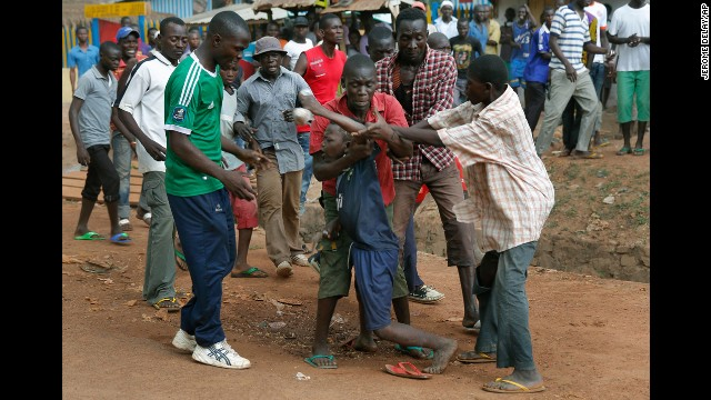 Mobs of Christians grab a child holding a knife in Bangui on December 9.