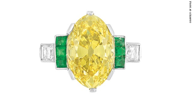 The period between the two world wars saw a fashion for colorful gems, such as this platinum fancy vivid yellow diamond and emerald ring which will be auctioned off at <a href='http://www.doylenewyork.com/' target='_blank'>Doyle New York</a>.