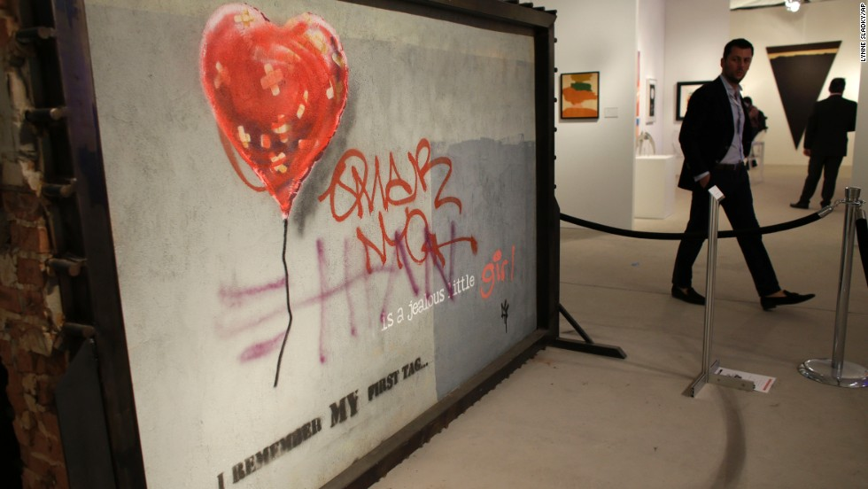 "A piece by graffiti artist Bansky titled ""Brooklyn Bandaged Heart"" is displayed at Art Miami, Sunday, December 8, in the Design District neighborhood of Miami. Art Basel, which ended December 8, featured works from 285 international galleries, representing 31 countries."