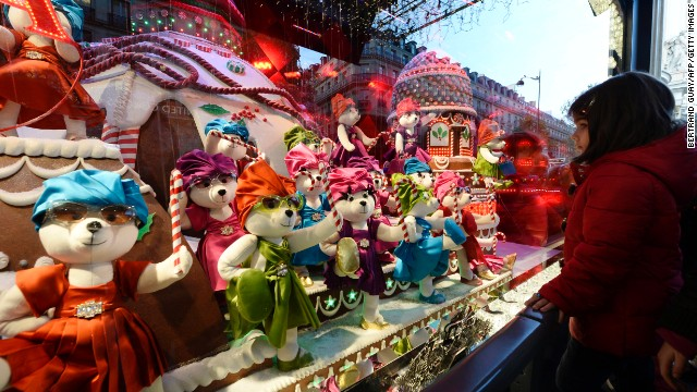 """A Joyful Obsession,"" Printemps, Paris: For more than a century, department stores have been creating fantastic window displays around the Christmas holidays. This year's highlights include 80 teddy bears that prance in the windows of French department store Printemps. Each of the bears wears miniature Prada. Gwyneth Paltrow unveiled these windows with much fanfare in November."
