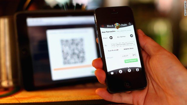 Customers scan a QR code to pay for drinks or food using Bitcoins at the Old Fitzroy in Sydney -- the first pub to accept the virtual coins in Australia.