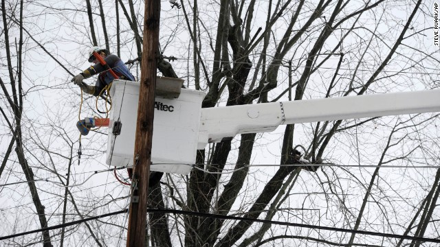 Baltimore Gas & Electric lineman Jim Thompson repairs a power line that was damaged by a tree limb in Towson, Maryland, on Monday, December 9.