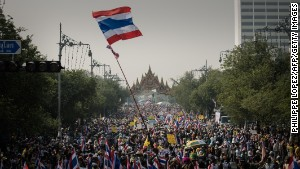 Demonstrators march towards the government building in Bangkok on December 9.