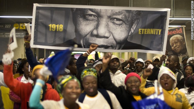 People arrive at FNB Stadium before the memorial service.