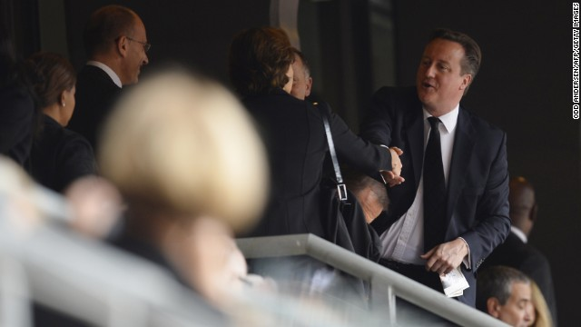 British Prime Minister David Cameron arrives for the memorial service.