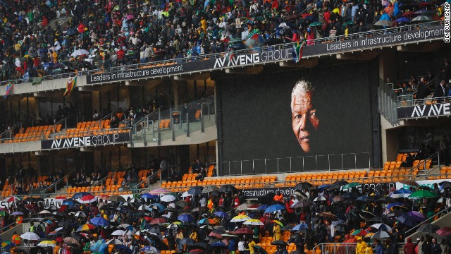 Mandela's face looms large on a billboard inside FNB Stadium.