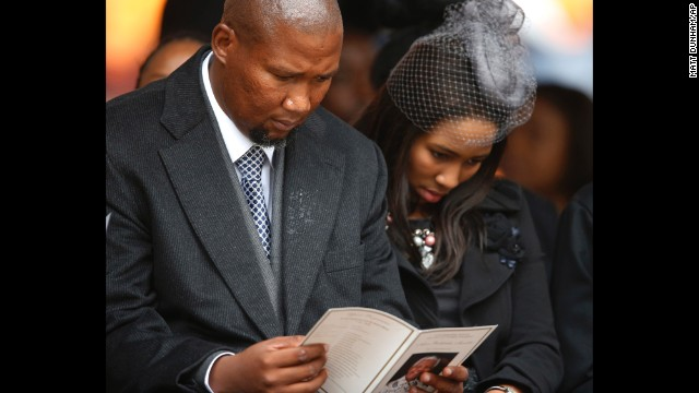 Mandla Mandela, left, grandson of Nelson Mandela, attends the memorial service.