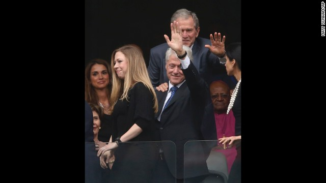 Former Presidents Bill Clinton and George W. Bush wave during the memorial service. Chelsea Clinton is at left.