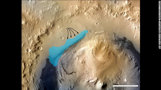 "An illustration depicts the possible extent of an ancient lake inside Gale Crater, where the Mars rover Curiosity landed on the Red Planet in August 2012. The $2.5 billion NASA mission set out to explore Gale Crater, which was thought to have once hosted flowing water. Curiosity found evidence of clay formations, or ""mudstone,"" in the crater's Yellowknife Bay, scientists said in 2013. This clay may have held the key ingredients for life billions of years ago. It means a lake must have existed in the area."