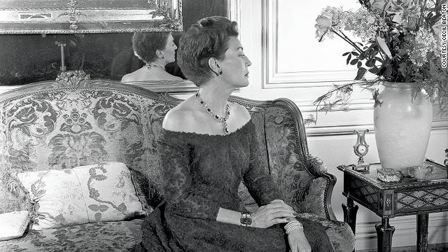 This picture shows Mona Bismark, photographed in Paris by Cecil Beaton in 1958. She is wearing her emerald and diamond cluster necklace and earclips by Cartier. On her right arm is her jade and diamond bracelet, on her left arm a her pearl bracelet with diamond and emerald clasp.