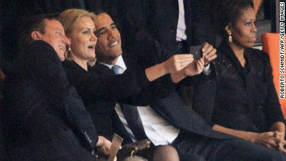 Denmark's Prime Minister Helle Thorning-Schmidt snaps a selfie with British Prime Minister David Cameron and U.S. President Barack Obama during the memorial service of South African former president Nelson Mandela in Johannesburg, South Africa on December 10.