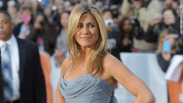 Jennifer Aniston rocked around the Christmas tree with Gwyneth Paltrow
