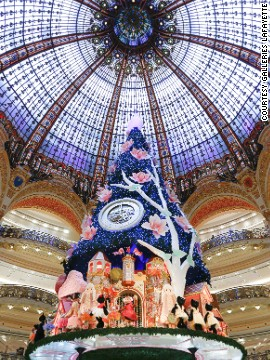 "The world's largest ""in-store"" Christmas tree was designed by Swatch. Batteries not included. Good luck getting it home."