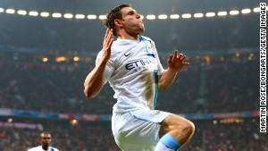 James Milner celebrates scoring Manchester City's third goal against Bayern Munich at the Allianz Arena on Tuesday.