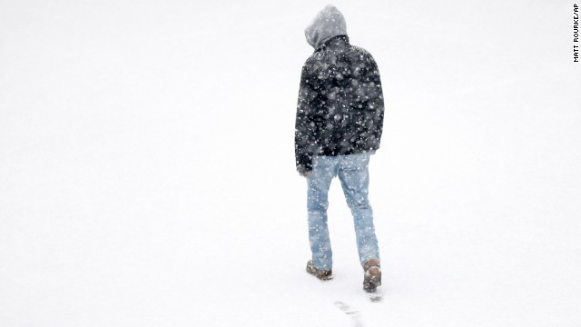 A man makes his way across a parking lot during a snowstorm in Philadelphia on December 10.