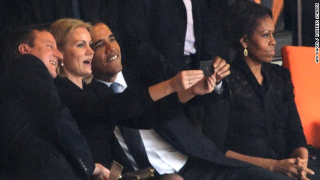 "All together now, smile! <!-- --> </br>Obama poses for a selfie with Helle Thorning-Schmidt, known as ""Gucci Helle"" in her country for her love of designer clothes, and Cameron. First Lady Michelle Obama looks elsewhere."