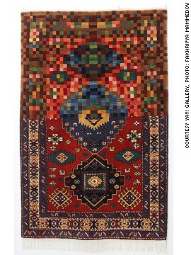 "Faig Ahmed's woolen handmade carpets are based on Azerbaijan's ancient weaving traditions. They are constructed by hand and, for the most part, follow a conventional design. In each case, however, Ahmed reconfigures part of the pattern. <!-- --><!-- --> </br></br> With this carpet, titled Pixelate Tradition, much of the pattern has disintegrated into pixels. By disrupting traditional forms, Ahmed aims to show how, ""Ideas that have been formed for ages are being changed in moments""."