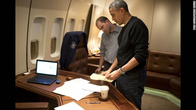 Aboard Air Force One, Deputy National Security Advisor Ben Rhodes edits the President's speech.