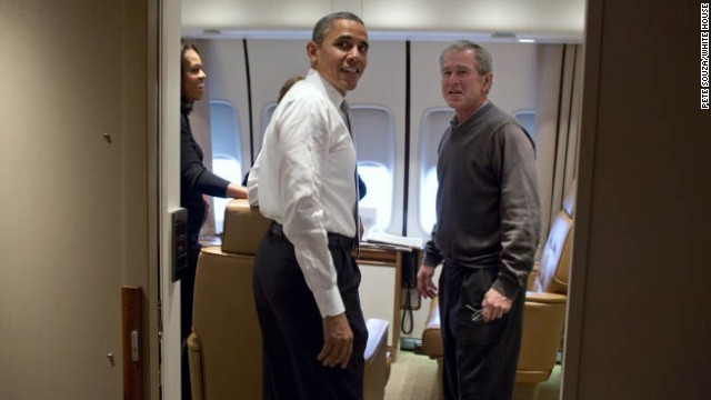 President Obama jokes with President Bush aboard Air Force One.