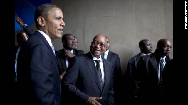 President Obama and South African President Jacob Zuma wait to take the stage at FNB Stadium.