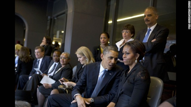 President Obama talks with the first lady.