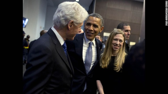 President Obama talks with former President Bill Clinton and his daughter Chelsea.